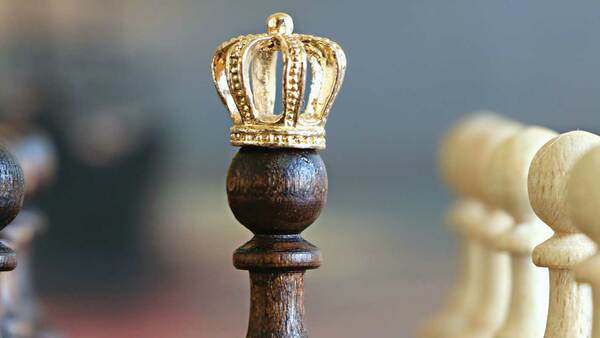 Chess piece with a crown