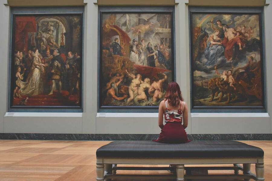 Woman sitting in an art gallery